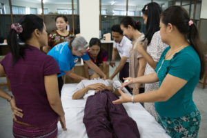 long-term volunteer and orthopaedic nurse Maggs Hamilton working alongside nurses and physiotherapists to deliver clinical skills training in Yangon, Myanmar.